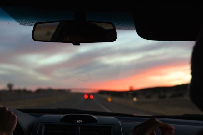 Desert sunset on the road