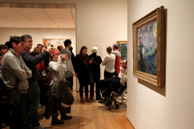 People taking photos of Starry Night